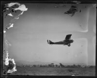 Biplane flying near Griffith Park Airport, Los Angeles, [1928?]