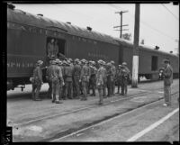California National Guard members next to train on Exposition Boulevard, Los Angeles, circa 1928-1939