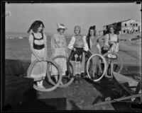 Newport Beach water parade, young women on Long Beach Chamber of Commerce float representing 1932 Olympics, Newport Beach, 1932