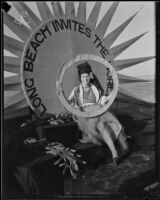 Newport Beach water parade, young woman on Long Beach Chamber of Commerce float representing 1932 Olympics, Newport Beach, 1932