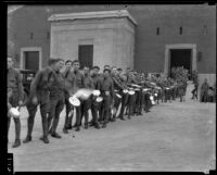 California National Guard members with mess kits outside Exposition Park Armory, Los Angeles
