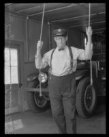 Firefighter William Vickers ringing fire bell, Orange, 1934