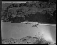 Colorado River, with barges preparing for construction of Parker Dam, near Parker (Arizona), 1934