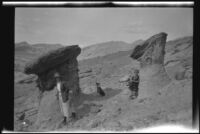 Sightseers at rock formations in Red Rock Canyon State Park, California, circa 1920-1930