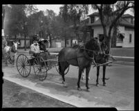 Man and woman in horse-drawn buggy, Old Timers Parade, Riverside, [1933?]