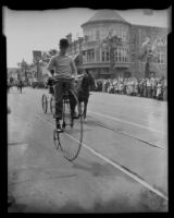 High-wheeled bicycle rider, Old Timers Parade, Riverside, [1933?]