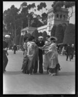 Sailor with four women in Spanish dress at the California Pacific International Exposition in Balboa Park, San Diego, 1935-1936