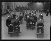 Sailors riding push carts at the California Pacific International Exposition in Balboa Park, San Diego, 1935-1936