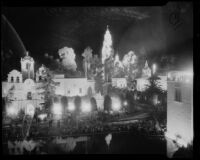 Night time view towards the House of Charm and tower of the Palace of Science at the California Pacific International Exposition, San Diego, 1935-1936
