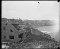Pueblo-revival style house on shoreline cliff, San Diego vicinity, 1920-1939