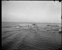 View from a pier toward water skiers and a swim platform, San Diego vicinity, 1920-1930