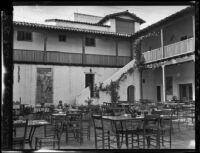 Restaurant Del Paseo tables in the El Paseo courtyard, Santa Barbara, [1930s?]
