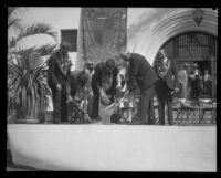 Ceremonial setting of a bronze medallion at the dedication of the Santa Barbara County Courthouse, Santa Barbara, 1929