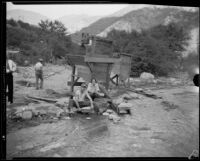 Gold miners Mr. and Mrs. Frank Robison panning for gold, San Gabriel Canyon, 1932