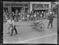 Santa Barbara Fiesta, men with cannon and rifle in parade, Santa Barbara, 1927