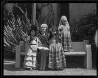 Woman and 3 little girls in Spanish dress at the Old Spanish Days Fiesta, Santa Barbara, 1932