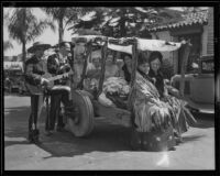 Women riding a cart serenaded by 2 men at the Old Spanish Days Fiesta, Santa Barbara, 1932