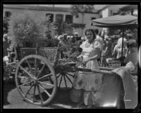 Woman at a display cart at the Old Spanish Days Fiesta, Santa Barbara, 1932