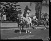 Two women in Spanish-style dress on horseback at the Old Spanish Days Fiesta, Santa Barbara, 1932