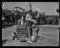 Woman showing terracotta pots at the Old Spanish Days Fiesta, Santa Barbara, 1932