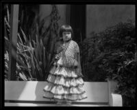 Little girl in Spanish dress at the Old Spanish Days Fiesta, Santa Barbara, 1932