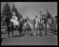 Possible bridal procession on horseback at the parade for the Old Spanish Days Fiesta, Santa Barbara, 1932