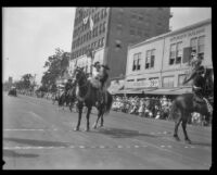 Couple on horseback in the parade for the Old Spanish Days Fiesta, Santa Barbara, 1930
