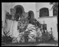 Dancers in the Old Spanish Days Fiesta on the rotunda staircase in the garden of the courthouse, Santa Barbara, 1930