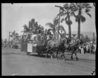 Float with costumed riders and greenery in the parade of the Old Spanish Days Fiesta, Santa Barbara, 1930