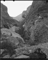 Young woman seated on rock, Topanga Canyon, [1920s or 1930s?]