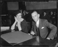 Arson suspect Robert D. Barr in court with defense witness Mary Lantz, Los Angeles, 1934
