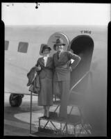 Actors Florence Rice and Michael Bartlett at door of airplane, 1935