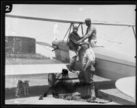 Adalaide F. Bassett, Frank E. Samuels, and pilot Paul E. Richter with biplane, [1920s?]