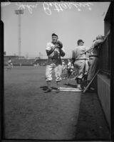 Baseball player John Bottarini with injured finger, 1936