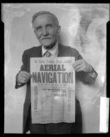Will W. Beach holding handbill advertising 1894 San Francisco flying stunt, 1927