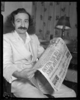 Mystic Meher Baba reading newspaper, Hollywood, 1932