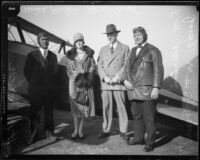 Actress Helene Millard, pilot H.A. Speer, Judge William S. Baird, and another man with airplane, [1927?]