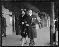 Newton D. Baker, former Secretary of War, and daughter Elizabeth Baker McGinn walking together, [Los Angeles?], 1927