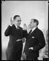 Judge Charles A. Ballreich being sworn in by judge Clement Nye, Los Angeles, 1935