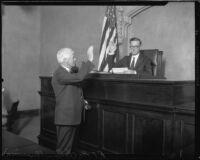 Judge Charles D. Ballard being sworn in by R.F. McClellan, Los Angeles County, 1931