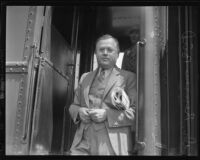 Occidental College president Remsen D. Bird at exit from train, Los Angeles, 1935