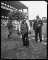 Los Angeles County Sheriff Eugene Biscailuz in baseball catcher's gear at Wrigley Field, Los Angeles, 1938