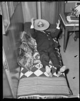 Los Angeles County sheriff Eugene Biscailuz resting under sombrero, 1958