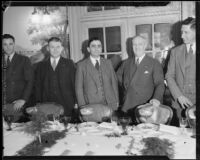 Los Angeles County sheriff Eugene Biscailuz and aviators Claude F. Morgan and P.G.B. Morriss at dinner at Hotel Clark, Los Angeles, 1934