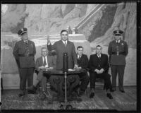 Los Angeles County sheriff Eugene Biscailuz and other county officials in front of mural, [1930s?]