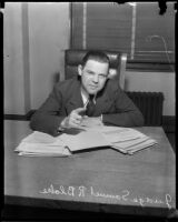 Juvenile Court judge Samuel R. Blake at desk with papers, [Los Angeles?], [1932?]
