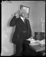 Los Angeles mayoral candidate Judge Benjamin Franklin Bledsoe with fist raised, [Los Angeles?], [1925?]
