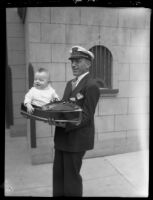 Kay Greer holding model boat and baby son Jack, Los Angeles Boat Show, Los Angeles, 1930