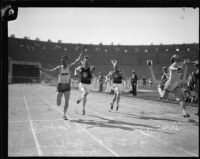Phil Barber, Charles Borah, an unidentified athlete and Russell Sweet race at an Olympic Club track team event at the Coliseum, Los Angeles, 1928