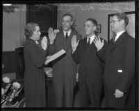Mame Beatty of the Board of Supervisors administering the oath of office to Herbert C. Legg, John Anson Ford, Gordon L. McDonough, in the Hall of Records, Los Angeles, 1934